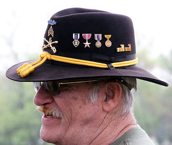 Roger Schneider | The Goshen News Vietnam War veteran LeRoy Harshberger, Goshen, wears his 1st Calvary hat to the Goshen Memorial Day service at Oakridge Cemetery. The ribbons Harshberger's hat is adorned with are his combat infantry  badge, a Purple Heart, a Bronze Star, an Air Medal, a Vietnam Service Medal and the year's he was in country, 1970 and 1971.