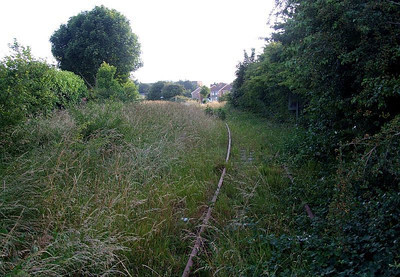 View west from Fareham Road, at the point where the level crossing was situated, looking along the track to Forest Way and Tichborne Way. 26th June 2009.