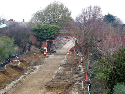 View to Brewers Arch from Tichborne Way on 25th December 2010, showing the trackbed prepared for surfacing; note the gauge pole at the arch.