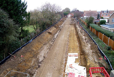 Distant view to Brewers Arch from Tichborne Way on 25th December 2010, showing the trackbed prepared for surfacing.