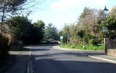 View west along Crescent Road; Elachie Road is on the right, and the railway crossed the road from where the red bin is, at the end of the cycleway. There was a level crossing here. 22nd March 2015.