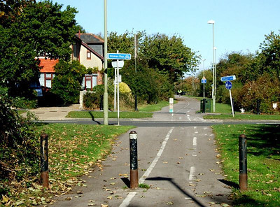 Looking north across Clayhall Road towards Jackie Spencer's bridge; until the late 1950's (or thereabouts) the road crossed the railway by way of Clayhall Arch. 12th October 2009.