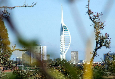 View  west from the trackbed just south of Jackie Spencer's Bridge - a distant shot of the Spinnaker Tower in Portsmouth. 12th October 2009.