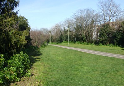 The trackbed/cycleway looking north from Crescent Road; the level crossing would have been immediately to the right. 22nd March 2015.