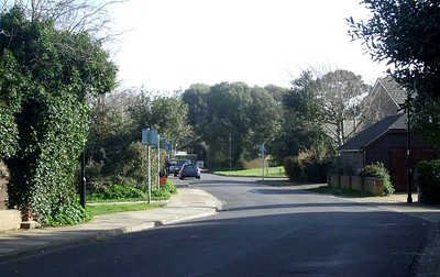 The southern end of the remaining trackbed (in the form of a cycleway) ends here, where the railway encountered a level crossing in Crescent Road. This view is looking southeast towards Haslar, and the crossing would have been here, in the foreground; the end of the cycleway can be seen on the left. The remainder of the trackbed between here and Fort Road has now been replaced by housing. 1st March 2015.