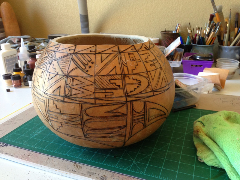 Here it is after the design has been sketched and then burned into the surface, ready to decide colors.