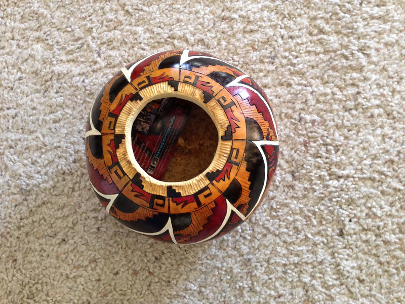 Canteen shape gourd, carved and painted, shown from the top.
