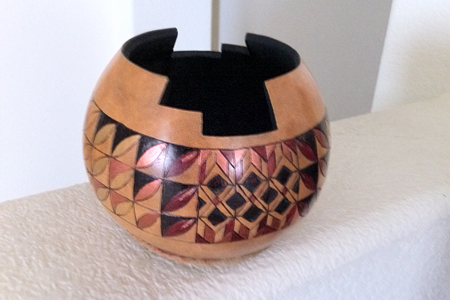 Mid-sized gourd with contemporary design and southwest 'cut'. Interior is painted black and outside is burned, painted and has a wax finish. Picture 1 of 2.