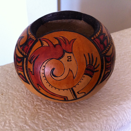 Sold. Small (softball sized) cannonball shape hand painted and burned gourd finished with leather dyes and wax. Designs are Hopi, bird is a parrot. Great business card holder.. or throw your loose change in this one!  Picture 1 of 2.