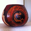 Sold. Midsize thick gourd with Hopi style design. Dyed, carved and burned. Wax finish. Picture 1 of 2