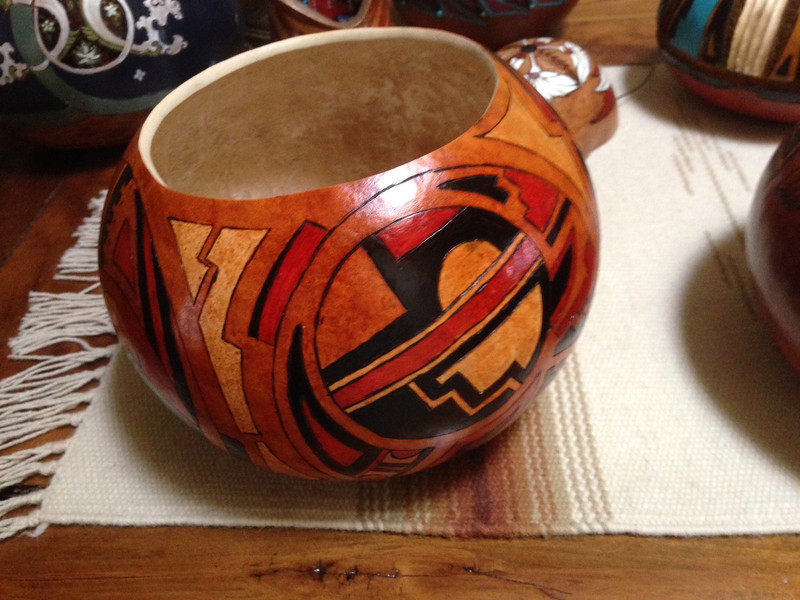 Sold - Contemporary southwestern graphics on this near perfect bowl shaped gourd.