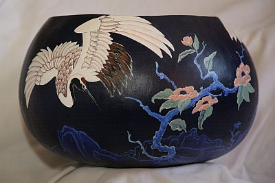 Sold. This very large gourd was painted with acrylic paints in a Japanese style with indigo blue paint. It had three cranes in various positions around the bowl.