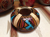 This little gourd is very thick, carved, burned, colored with both paint and dye. it is finished with clear acrylic. The design is influenced by the Hopi art.