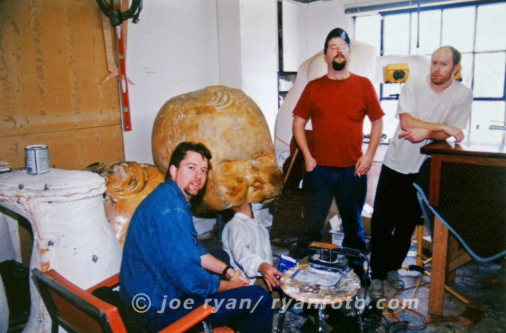 The Gourds posing with a giant baby doll head<br /> just before we left the warehouse for the last time<br /> San Francisco, CA<br /> February 11, 1998