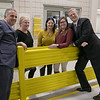 Gov. Charlie Baker took a tour of AIS in Leominster to celebrate October as Manufacturing Month in Massachusetts on Wednesday, Oct. 9, 2019. Leominster Mayor Dean Mazzarella, on left, and Gov. Baker pose with AIS employees, from left, Tammy Walsh, Erika Kunhardt and Dorka Romero. SENTINEL & ENTERPRISE/JOHN LOVE