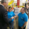 Gov. Charlie Baker took a tour of AIS in Leominster to celebrate October as Manufacturing Month in Massachusetts on Wednesday, Oct. 9, 2019. Gov. Baker stopped to talk to some employees as he toured the plant. He shakes hands with Group Leader Carlos Santiago. SENTINEL & ENTERPRISE/JOHN LOVE