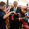 Gov. Charlie Baker is visiting Nashoba Tech on Wednesday to tour the school's Engineering Academy. The Academy received $495,000 in state grant funding last year and has upgraded classroom equipment using that funding. They held a ribbon during his visit for the Engineering Academy. Just after the ribbon cutting senior Drew Norton, 17, from Townsend showed Baker how their robotic arm could grab his wallet. Just behind baker is Jeff Scheminger, in white shirt, the engineering and robotics instructor. SUN/JOHN LOVE