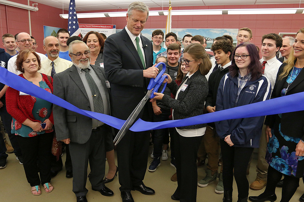 . Gov. Charlie Baker is visiting Nashoba Tech on Wednesday to tour the school\'s Engineering Academy. The Academy received $495,000 in state grant funding last year and has upgraded classroom equipment using that funding. They held a ribbon during his visit for the Engineering Academy. Helping Baker cut the ribbon is Nashoba Tech\'s Superintendent Denise Pigeon. SUN/JOHN LOVE