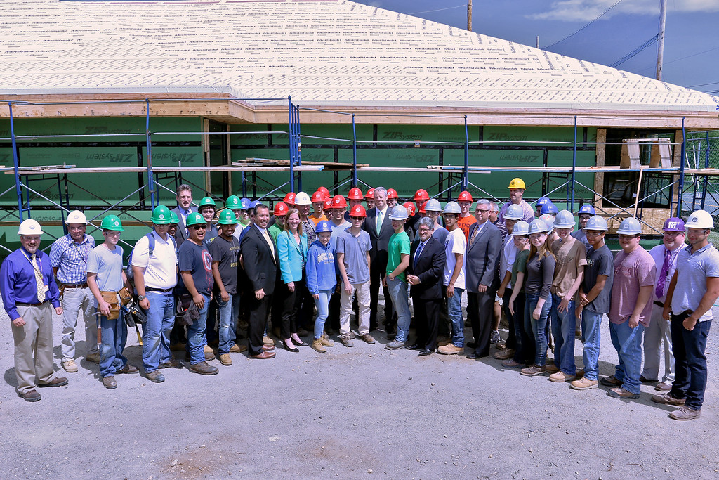 . During Gov. Charlie Baker visit to Montachusett Regional Vocational Technical School\'s new veterinary center that was still under construction he and other local and state officials posed with the student and faculty. SENTINEL & ENTERPRISE/JOHN LOVE
