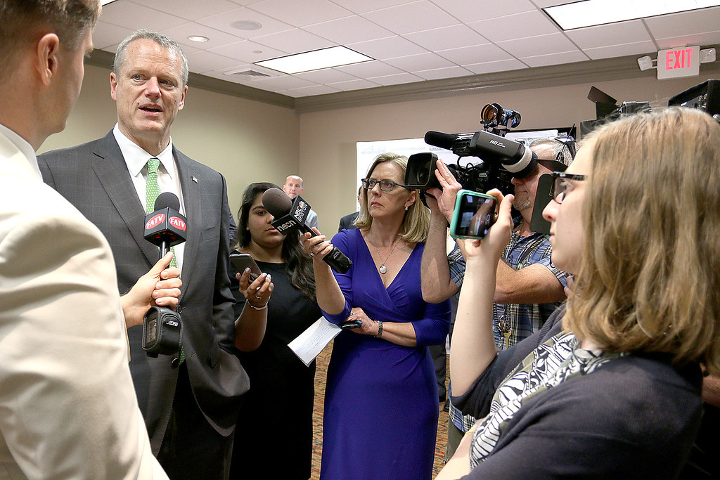 . Governor Charlie Baker answers some questions from the press after the North Central Massachusetts Chamber of Commerce annual business meeting at Great Wolf Lodge New England in Fitchburg. SENTINEL & ENTERPRISE/JOHN LOVE