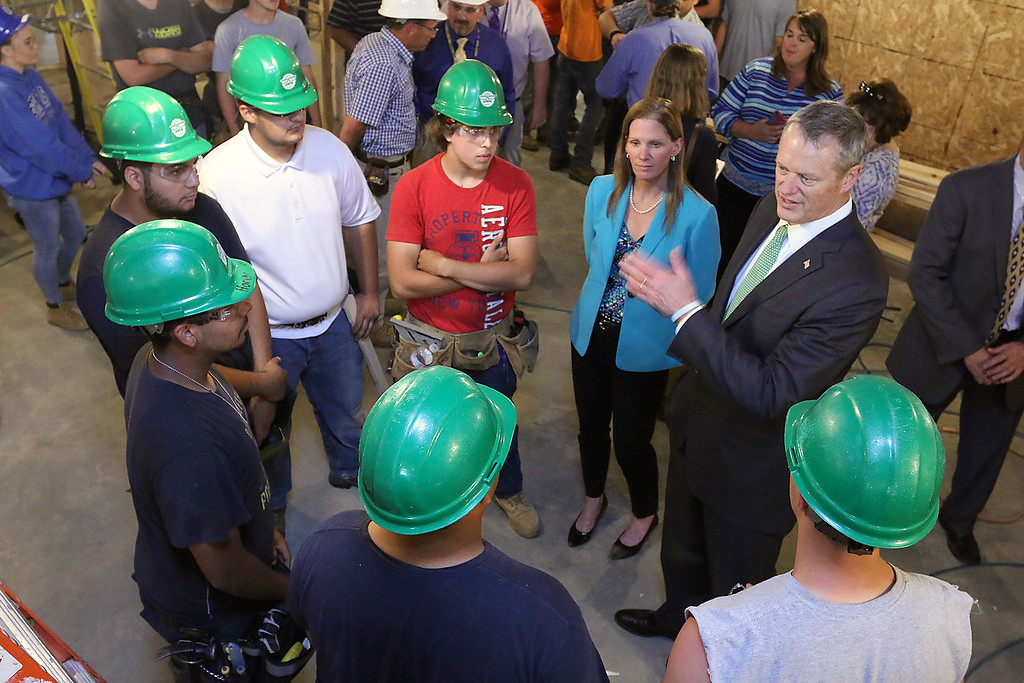 . Gov. Charlie Baker talks with Montachusett Regional Vocational Technical School juniors learning the carpentry trade during his visit to the schools veterinary center that was still under construction. Clockwise from the bottom right is Patrick Dillon, Justin Newman, Ruben Rodriguez, Giovanni Gonzalez, Max Potter, Marcus Whitney and the schools Superintendent Sheila Harrity. SENTINEL & ENTERPRISE/JOHN LOVE