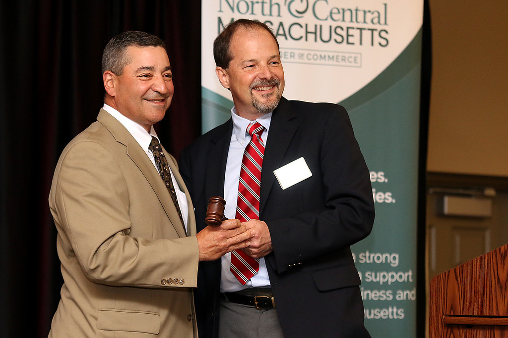 . During the North Central Massachusetts Chamber of Commerce annual business meeting at Great Wolf Lodge New England in Fitchburg they had a change of the Chairman of the Board and Tony Mercadante, on left, handed over the gavel to Mark Freeman. SENTINEL & ENTERPRISE/JOHN LOVE