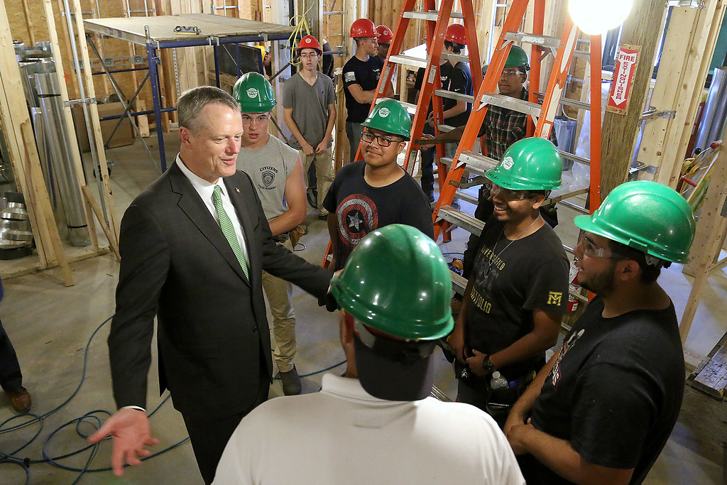 . Gov. Charlie Baker talks with Montachusett Regional Vocational Technical School juniors learning the carpentry trade during his visit to the schools veterinary center that was still under construction. Clockwise from the top is Patrick Dillon, Justin Newman, Ruben Rodriguez, Giovanni Gonzalez, and Max Potter. SENTINEL & ENTERPRISE/JOHN LOVE