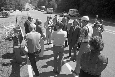 Gov. George  Deukmejian talks with highway officials and crew during a tour of the Redwood National Park bypass construction area in July 1984.  (Times-Standard file photo)