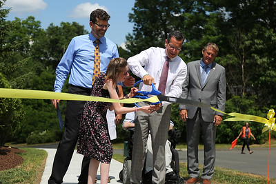 Gov. Dannel P. Malloy and Lauren Traceski cut the ribbon celebrating a new sidewalk that leads down to the Farmington River Trail. That was funded by a Governor's Nonprofit Initiative grant of $60,000 awarded to us in 2015.The money also funded new automated front doors for FAVARH's main building on Commerce Drive.  Photo by John Fitts