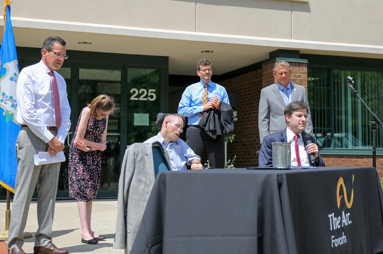 Jonathan Slifka, the governor's liaison to the disability community, speaks at the bill-signing ceremony.   Photo by John Fitts