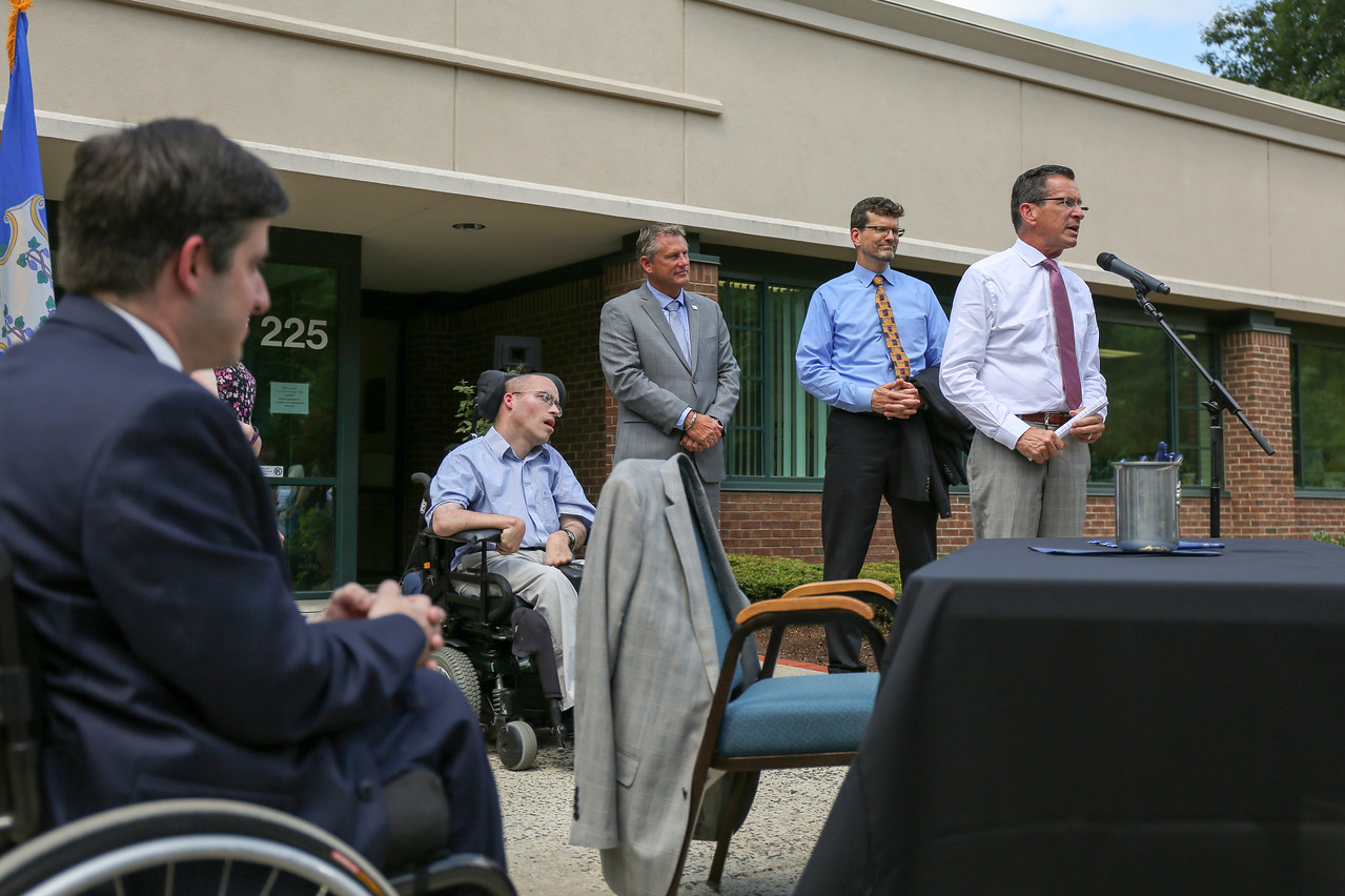 Gov. Dannel P. Malloy came to FAVARH's headquarters in Canton on Wednesday, June 29, 2016 to sign legislation modernizing the symbol the state uses to designate parking for those with disabilities.   Photo by John Fitts