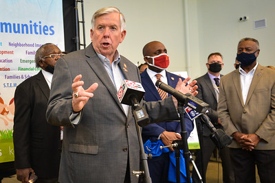 MIke Parson talks to reporters at Morningstar Missionary Baptist Church in April.