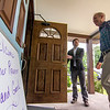 Gov. Bruce Rauner walks into Karla's Down Home Diner while campaign staffer Alex Browning holds the door Wednesday afternoon in Greenup.<br /> Keith Stewart Photo