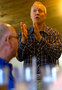 Gov. Bruce Rauner speaks while Steve Wheeler of Trilla listens at Karla's Down Home Diner in Greenup Wednesday afternoon. Keith Stewart Photo