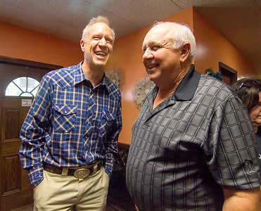 Gov. Bruce Rauner, left, is greeted by Cumberland County GOP Chairman Phil Sherwood Wednesday afternoon at Karla's Down Home Diner in Greenup. Keith Stewart Photo