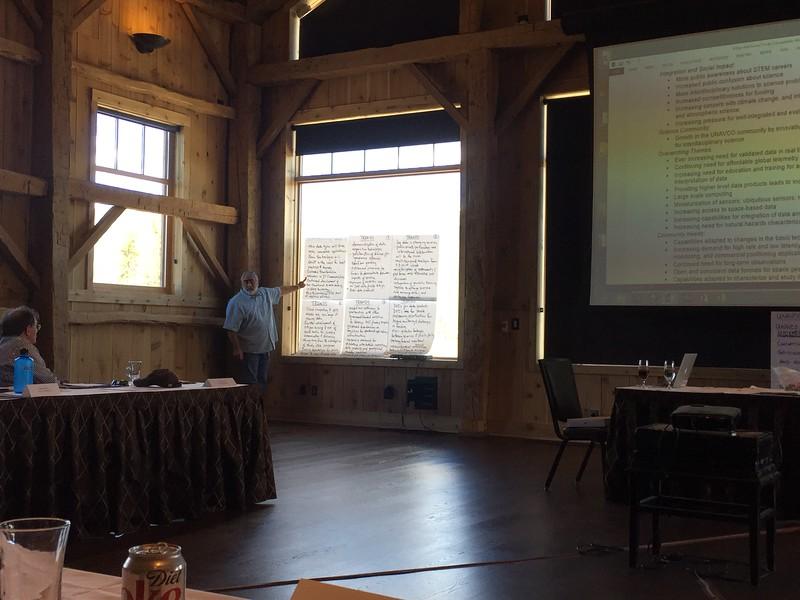 UNAVCO Strategic Planning June 8-9, 2015; Devil's Thumb Ranch, Tabernash, Colorado. Roy Savoian reviews community input while Glen Mattioli looks on. (Photo/Donna Charlevoix, UNAVCO)
