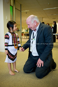 Multicultural Services Officer Peter Spyker meets Burmese Refugee child Lun Vung during Refugee Week with the Burmese Cultural display.