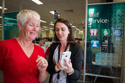 DHS staff member Maree Farrell demonstrates various apps with a customer at the Tweed Heads Service Centre
