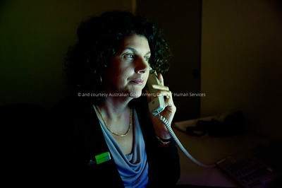Victoria Park Service Centre Manager Jenny Cannavo at her desk at the Centre. Shot captured quickly at the end of the shooting day to possibly be Jenny on an early morning pre-office hours call with Canberra