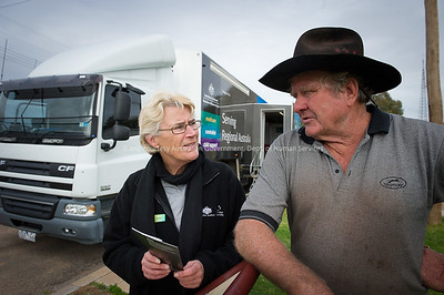 DHS staff member Carmel Lineham in discussions with customer David Bert at the Mobile Offices set up in Menindee, NSW