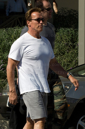 Governor Arnold Schwarzenegger drive his new toy,a brand new Porsche 911 Turbo Cabriolet in Brentwood,California.