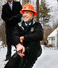 HOLLY PELCZYNSKI - BENNINGTON BANNER Governor Phil Scott turns the valve to open the water line with clean water at 495 Fairview Street in Bennington on Monday afternoon.