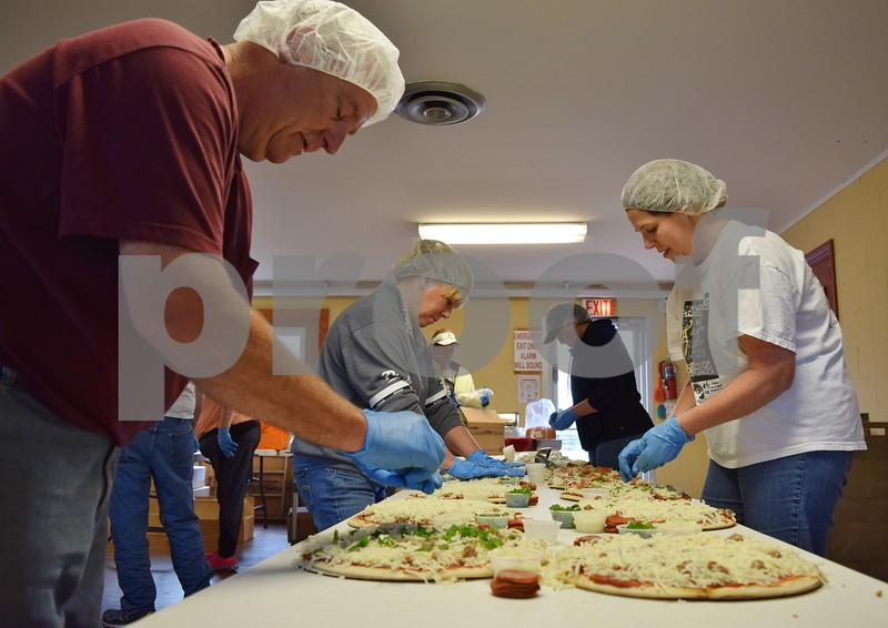 On April 30, The Gracie Center's crew and volunteers made 720 pizzas as a fundraiser for the organization's programming for adults with developmental disabilities. The pizza was pre-ordered and sold that afternoon and also will be sold at The Gracie Center's PopUp Shop.