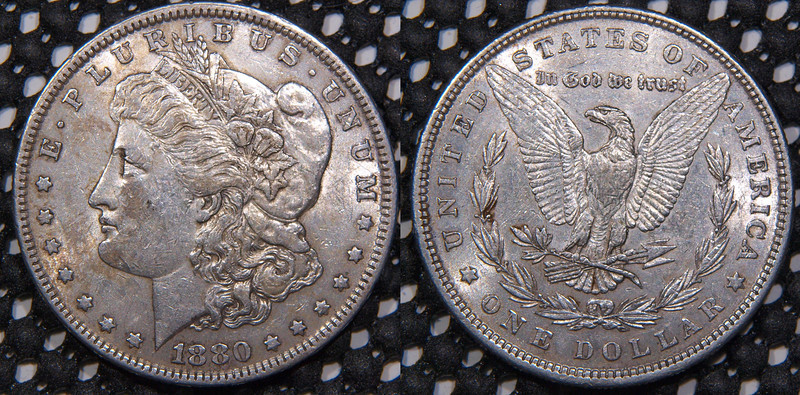 1880-P Morgan<br /> Stains on coin much less evident in hand than in pics<br /> AU, prob<br /> $39<br /> <br /> contact me at leo78256@yahoo.com