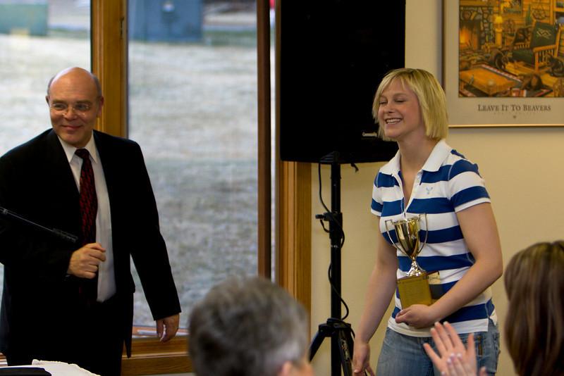 President Michael Mace congratulates Nichole Ruske on winning the Presidents Cup (Graduating class 2008)