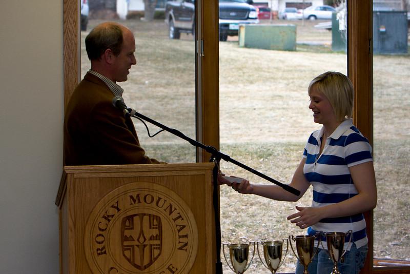Nichole Ruske winner of the Presidents Cup (Graduating class 2008) receives an award from Dan Albrecht of the Biology program.
