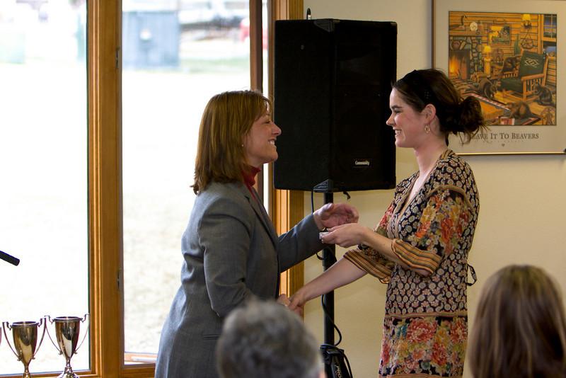 Carlie Breen winner of the Deans Cup (Graduating class 2008) receives an award from Karen Beiser of the Business program.