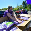 KRISTOPHER RADDER — BRATTLEBORO REFORMER<br /> Meghan Pacheco, a school counselor at Brattleboro Union High School, in Brattleboro, Vt., gathers caps and gowns for graduating seniors as they drive past on Friday, May 22, 2020.