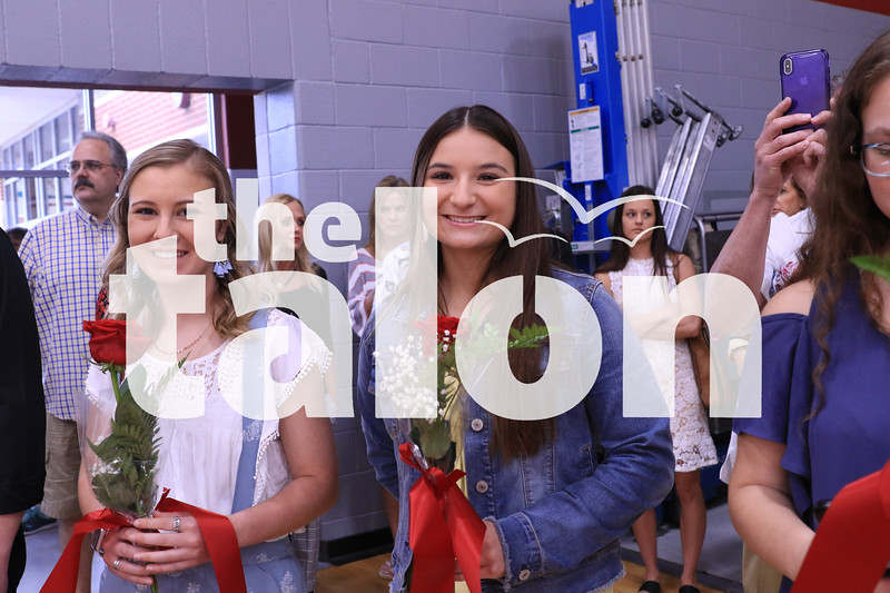 Seniors cut roses during the ceremony at Argyle High School, in Argyle,TX. May 21, 2019, (Katy McBee / The Talon News)