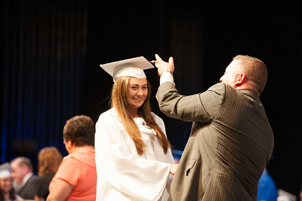 140628 JOED VIERA/STAFF PHOTOGRAPHER-Buffalo, NY-Newfane Principal Thomas Stack flips graduate Gabrielle Burns' tassle during Newfane's graduation ceremony at UB's Center for the Arts. June 28, 2014